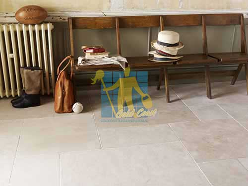 Gold Coast limestone tile sample storm tumbled white grout wooden chair