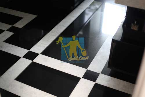 polished black marble tiles with white stripes in a floor_pattern