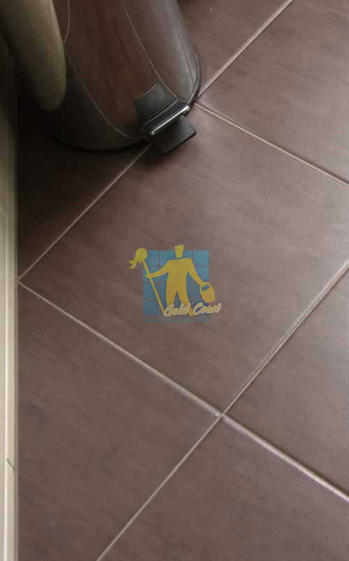 close shot sample of porcelain tiles brown with light grout lines