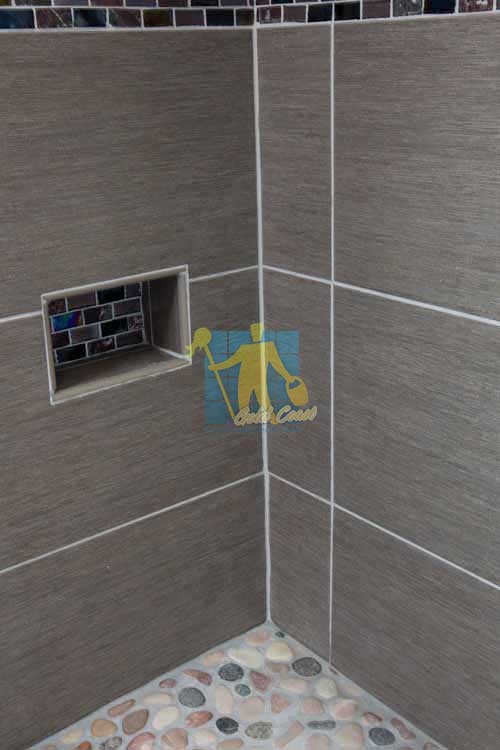 large format dark porcelain tile on shower_walls with grey grout lines