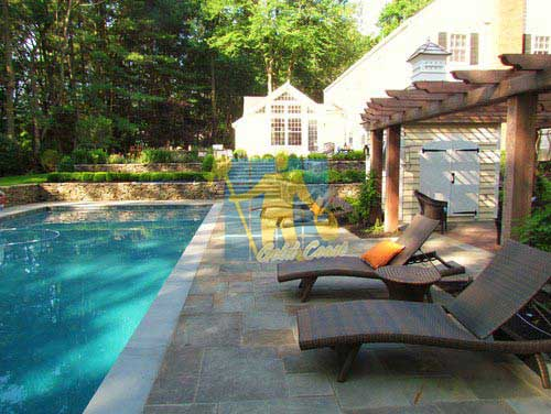 stone tiles around swimming pool white copping