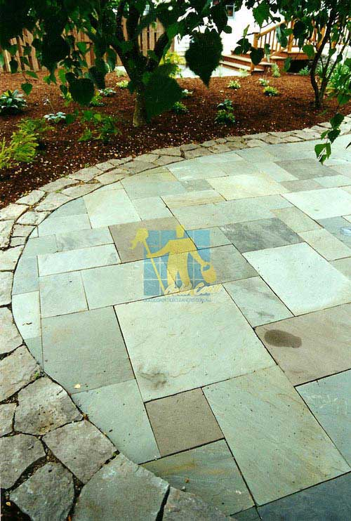 high_pressure_cleaning stone tiles outdoor patio border no grout