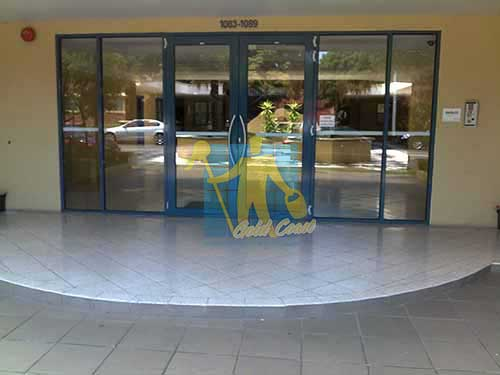 terrazzo tiles building entrance empty before cleaning angle shot reflection